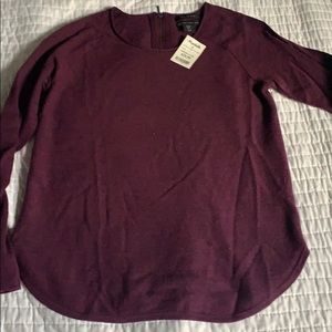 Burgundy sweater with zipper on back